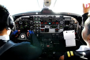 two_pilots_in_cockpit_of_plane_18392609