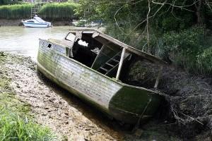 sunken boats pulled Louisiana bayous