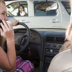 distracted teen on cell phone
