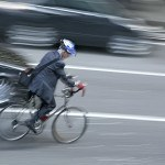 car passing bicyclist