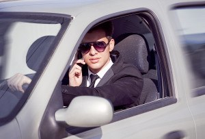 man driving while on cell phone