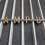 campus sign on the steel rails