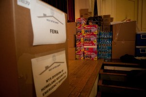 Food stacked up in auditorium of the Islip Town Hall awaiting distribution to survivors of Hurricane Sandy. Photo b Ed Edahl/FEMA