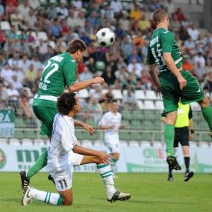 soccer player heads ball