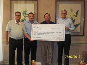 Steve Math (second from left), Texas Mutual senior vice president of underwriting; and Rich Gergasko (right), Texas Mutual president and CEO; present a $398,735 dividend check to Curtis Heptner (left), master agent for the Texas Alliance of Energy Producers (TAEP) safety group; and Alex Mills, TAEP president.