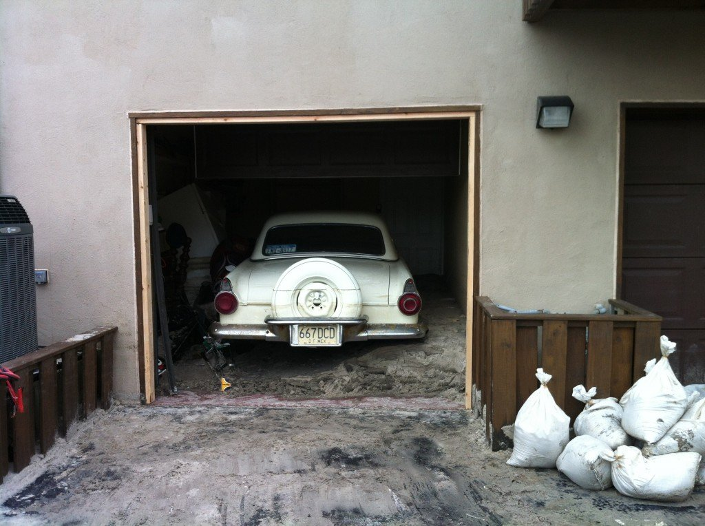 Superstorm Sandy inundated numerous homes along the East Coast near bays, rivers, lagoons, lakes and the Atlantic Ocean. Despite protecting his garage and car with sandbags, the owner of a 1956 Ford Thunderbird convertible in Long Beach, New York had to shovel sand out of the garage to get to his collector vehicle after the storm passed. Photo: ACI