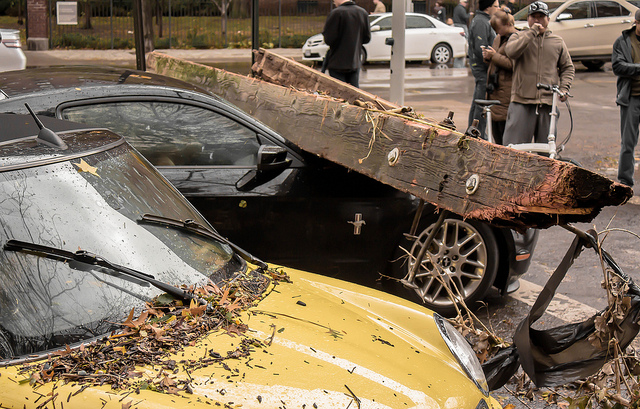 Superstorm Sandy moved these cars more than three blocks away from where they were parked in the New York region in October 2012. A piece of a pier that broke apart ended up on top of the Ford Mustang. Photo courtesy Patrick McFall.
