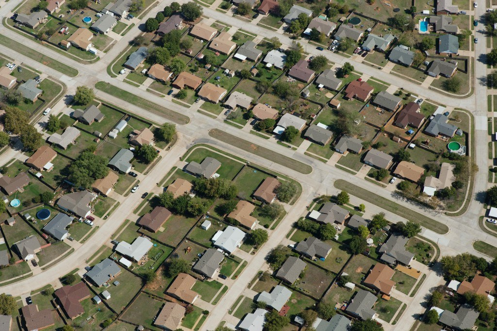 An aerial view of a typical suburban area. High-resolution aerial imagery such as this allows insurance professionals to extract massive amounts of data that can improve claims handling. Photo: Xactware