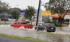 Cars pass through flooded areas in Texas. Jocelyn Augusitno/FEMA