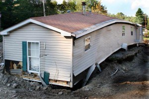 This trailer home was ripped off its foundation and broken in half by tropical storm Irene's flooding. The storm left acres of silt and debris as a result of the state wide flooding. Photo by Angela Drexel/FEMA