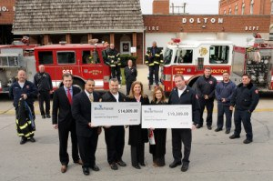 left to right: Steven Leardini, Andre Youngblood, Fire Chief Rich Gallaga of Summit Fire Department, Gina Wachtel, Leslie Rippley and Fire Chief Terence Hughes of Dolton Fire Department celebrate 2 million dollar milestone! (Photo: Business Wire)