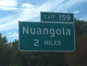 ACCEPTABLE: Example of appropriate use of Clearview for destination legend (mixed-case) and FHWA Standard Alphabets for other legends (all upper-case and numerals). Photo: DOT/FHA