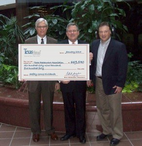 Rich Gergasko (left), Texas Mutual president and CEO; and Steve Math (right), Texas Mutual senior vice president of underwriting; present a $669,540 dividend check to Richie Jackson, Texas Restaurant Association CEO.