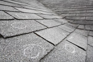 Old roof with hail damage, chalk circles mark the damage. Shallo