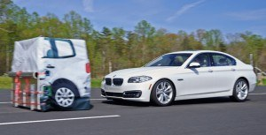 The BMW 5 series brakes for the target in an IIHS test. The car earns a superior rating when equipped with an optional camera and radar system. Photo: IIHS