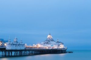 Eastbourne Pier illuminated at dusk, East Sussex, UK