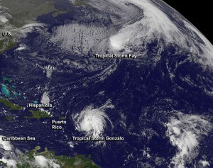 This visible image from NOAA's GOES-East satellite on Oct. 13 at 1145 UTC (7:45 a.m. EDT) shows Tropical Storm Fay northeast of Bermuda and Tropical Storm Gonzalo over the Lesser Antilles. Image Credit:  NASA/NOAA GOES Project