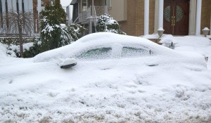 Car completely under snow after massive winter storms strikes No