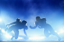 American football players in game, touchdown. Night stadium ligh
