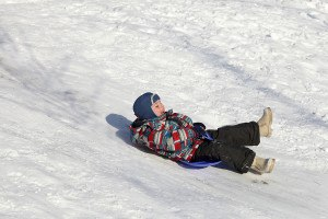 Child Slides On A Board