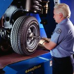 Tire test technician Terry Barrett makes some final adjustments to the Goodyer Fortera HL tire on the Flat Trac, a tire test that measures lateral force on a moving tire.  Photo: Goodyear