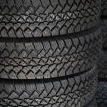 close up of a stack of new tires.