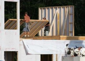 Putting up wall on modular home.