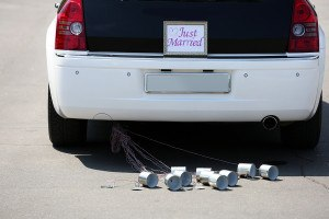 Wedding car with just married sign and cans
