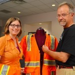 Doctoral student Kristen Hines and Professor Tom Martin of Virginia Tech's College of Engineering discuss the current version of the InZoneAlert safety vest. Image: Virginia Tech