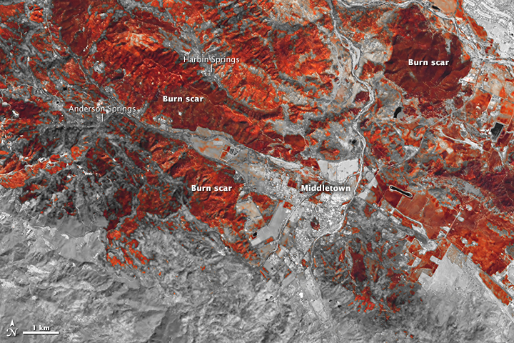 NASA Earth Observatory images show burn scars from the <a href=
