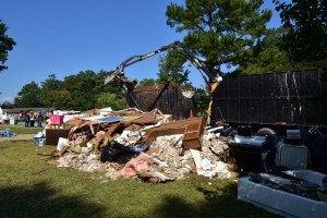 Columbia, SC, October 13, 2015 -- Residents watch their flood damaged belongings get loaded into a truck as debris removal begins in this neighborhood. FEMA/Bill Koplitz