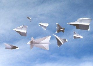 Photo illustration of paper airplanes in near miss scenario by BYU Photo.