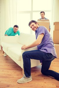 moving, real estate and friendship concept - smiling male friend