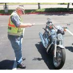 FHA investigator examines a motorcycle. Image: FHA