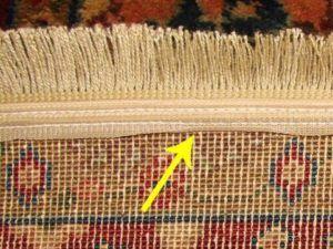 Machine-made rug with sewn on fringe. Photo: Enservio