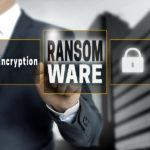Ransom Ware Touchscreen Is Operated By Businessman