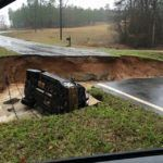 Louisiana flood washes out road and vehicle.Photo provided by state of Louisiana