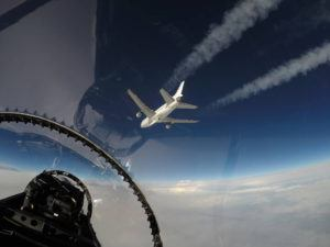 NASA's F-18 support aircraft was used to provide live coverage of the Orbital ATK L-1011 air-launch of its Pegasus XL rocket carrying CYGNSS. This photo was taken by Armstrong videographer, Lori Losey, as the AFRC F-18 chased Orbital's L-1011 carrier aircraft. Image Credit: NASA/Lori Losey