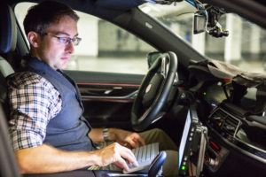 BMW engineer, André Mueller does an automated driving technology check.  Photo: BMW