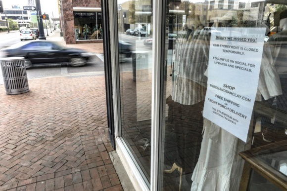 A store with a sign in window (COVID-19 business interruption)